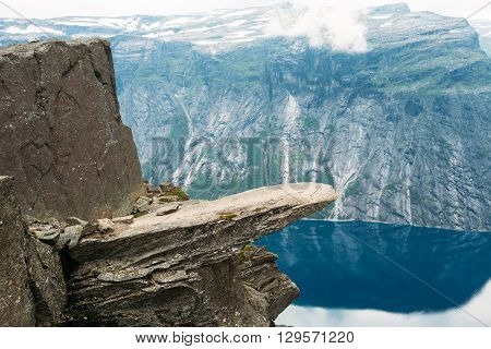 Scenic View Of Rock Trolltunga - Troll Tongue In Norway. Rock In The Mountains Of Norway. Natural Attractions Landmark