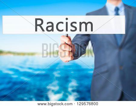 Racism - Businessman Hand Holding Sign