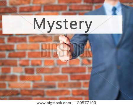 Mystery - Businessman Hand Holding Sign