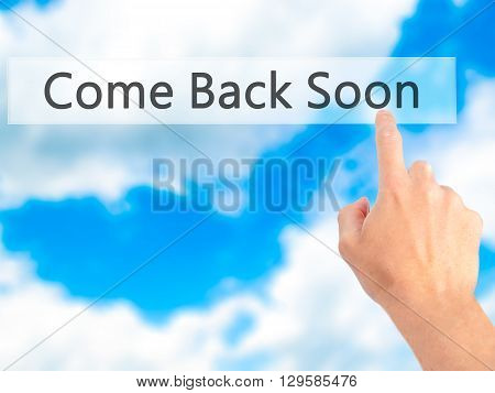 Come Back Soon - Hand Pressing A Button On Blurred Background Concept On Visual Screen.