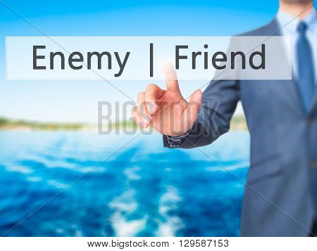 Enemy  Friend - Businessman Hand Pressing Button On Touch Screen Interface.