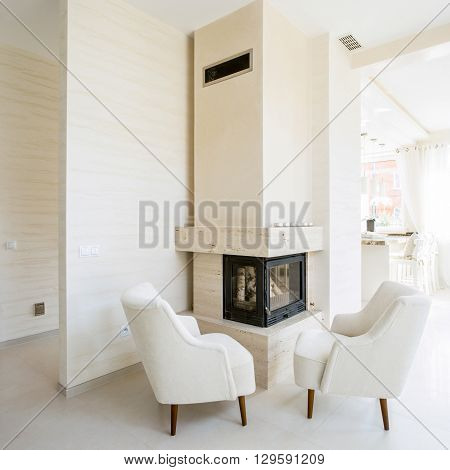 Modern fireplace in white spacious living room