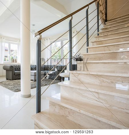 Stone staircase placed in modern living room