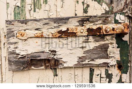 Detail Of Old Hinge On Wooden Door