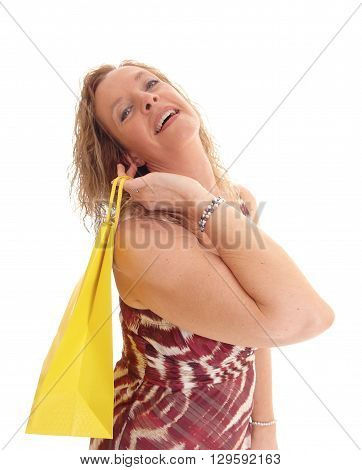 A portrait image of a blond woman in a summer dress and yellow shopping bag over her shoulder isolated for white background.