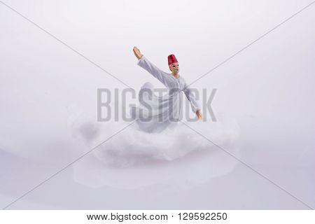 Sufi Derviş on a Cloud on a white background