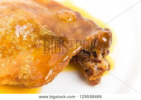 Duck leg confit with yellow sauce. Macro. Photo can be used as a whole background.
