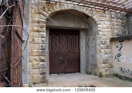 JOLIET, ILLINOIS / UNITED STATES - NOVEMBER 7, 2015: The back door of the old Illinois State Penitentiary in Joliet, Illinois.