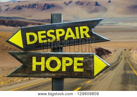 Hope - Despair crossroad in a desert background