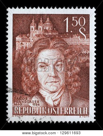 ZAGREB, CROATIA - JULY 03: A stamp printed by AUSTRIA, shows portrait of famous Austrian Baroque architect Jakob Prandtauer against Melk Abbey Church, circa 1960, on July 03, 2014, Zagreb, Croatia