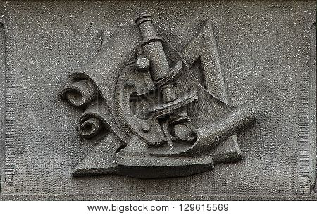 outdoor bas-relief of signs of exact sciences on the buildings wall of tech university