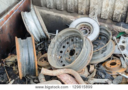 Useless, worn out rusty brake discs shock absorber and other parts