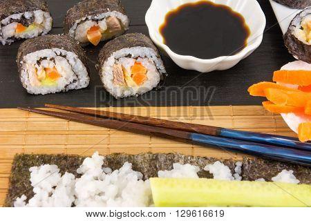 Preparing Sushi. Sushi Rolls And Chopsticks