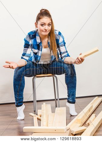 Worried Woman Assembling Wooden Furniture. Diy.