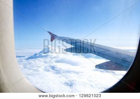 Clouds from the plane. View of the wing.