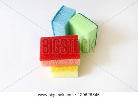 Colorful scouring and sponge on white isolated background
