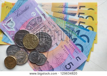Assorted Australian Currency - fifty dollar notes, ten dollar notes, five dollar notes - with an assortment of coins / change.
