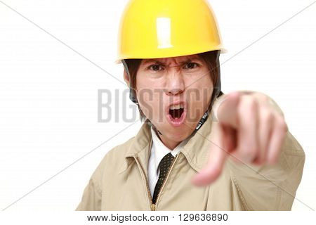 portrait of young Japanese construction worker scolding on white background
