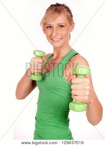 Blonde attractive woman doing her exercise with bar-bells