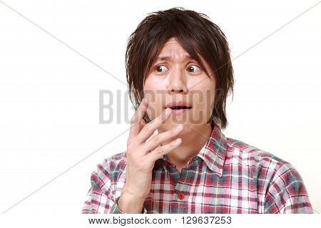 portrait of panicking man on white background