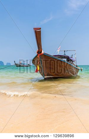 Traditional long-tail boat on the Ao Nang beach Krabi Thailand