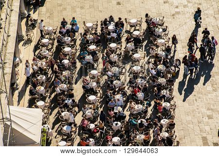 VENICE, ITALY - APR 19, 2016: people in the cafe around the Markus Place, the central place in Venice. Italy.