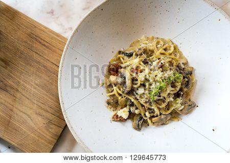 Spaghetti with black truffle and sundried tomato