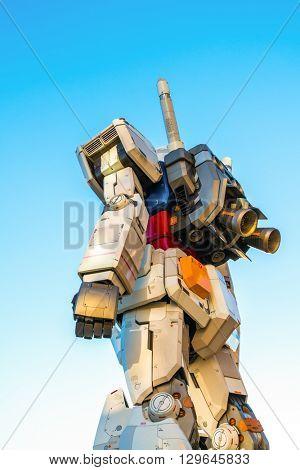 Full size Gundam Performances Outside DiverCity Tokyo Plaza, Odaiba, Tokyo, Japan - 27 November 2015: It is 18m tall The sculpture of famous anime franchise robot, Gundam.
