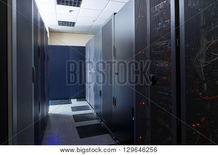 room with ommunication equipment and mainframe in data center rows