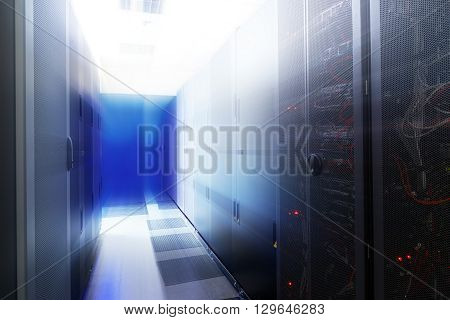 room with rows of server hardware in data center