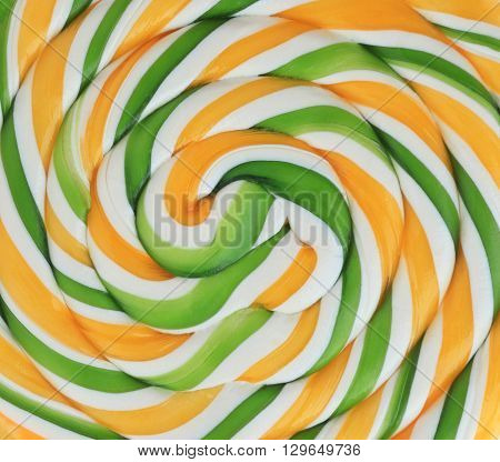 colorfull background from bright sweet spiral lollipop