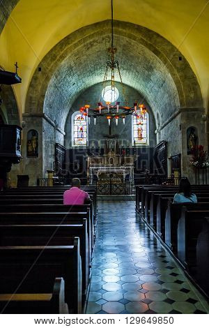 Saint-Paul de Vence, France - May 22: This is interior in French Catholic chapel of the brotherhood of the White penitents in the Provencal village of Saint-Paul de Vence May 22, 2015 in Saint-Paul de Vence, France.