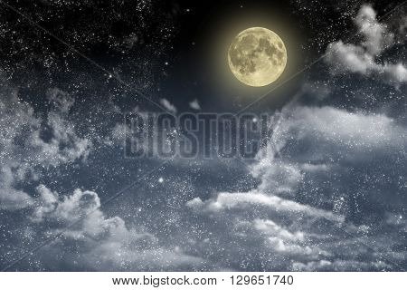 Beautiful magic blue night sky with clouds and fullmoon and stars closeup