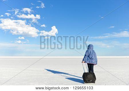 A girl head on horizon on white salt lake - Bonneville, Utah
