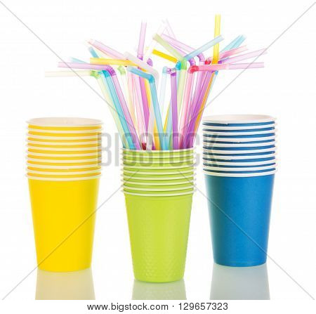 Multi-colored paper cups and cocktail straws isolated on white background
