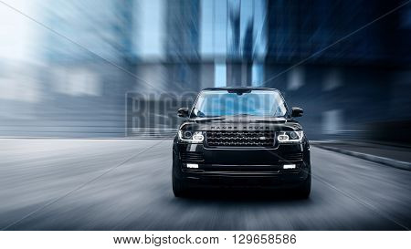 Moscow, Russia - November 22, 2015: Premium car Land Rover Range Rover fast drive on road in the city at daytime