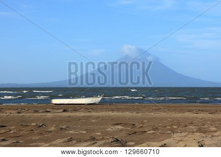 fishing boat on the background of the lake Nicaragua and volcano Concepcion.