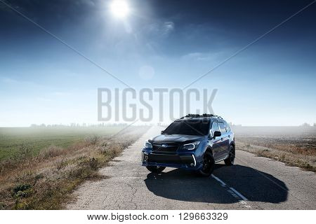 Saratov, Russia - October 21, 2015: Blue car Subaru Forester standing on asphalt road at countryside at daytime