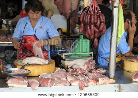 Vendor At The Fresh Meat Market In The Heart Of Cambodia