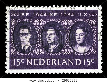 ZAGREB, CROATIA - JUNE 24: a stamp printed in the Netherlands shows King Baudouin, Queen Juliana and Grand Duchess Charlotte, Benelux, circa 1964, on June 24, 2014, Zagreb, Croatia