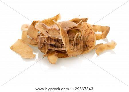 Garbage. Potato peelings isolated on white background