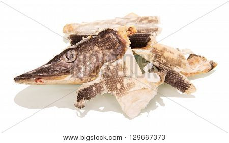 Garbage. Head and cleaning dried pike isolated on white background