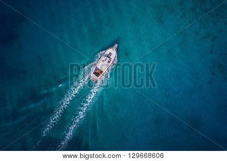 Vintage wooden boat in coral sea. Vintage boat. Vintage Yacht. Yacht theme. Vintage theme. Vintage ship. Yacht background. Yacht drone view. Boat drone photo.
