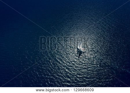 Amazing view to Yacht sailing in open sea at windy day. Drone view - birds eye angle. Yachting theme. Yachting background. Sailing time. Sailboat. Yacht. Luxury yacht.