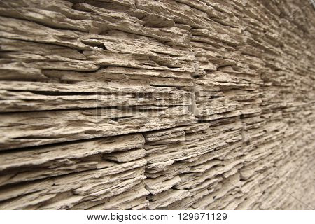 Wooden wall perspective view wall with plaster background. Blurred background