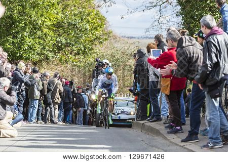 Conflans-Sainte-HonorineFrance-March 62016: The British cyclist Simon Yates of Orica-GreenEDGE Team riding during the prologue stage of Paris-Nice 2016.