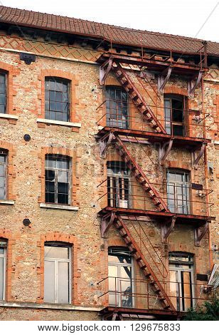 Long Rusty Fire Escape In Industrial Building Abandoned