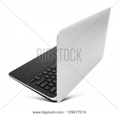 Hovering aluminium laptop rear view isolated on a white background.