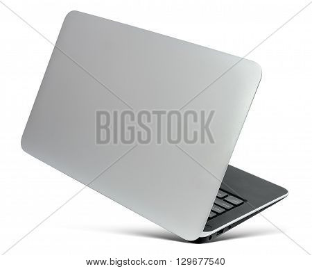 Flying thin aluminium laptop rear view with a popular design isolated on a white background.