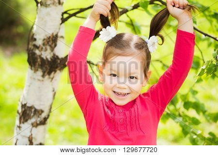 Closeup Portrait Of Funny Little Toddler Girl